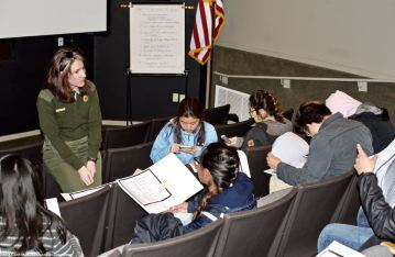 Most of the students had family who were incarcerated in one or more of the World War II American concentration camps, or other confinement sites. Manzanar National Historic Site Ranger Rose Masters provided them with copies of camp rosters with information about their families, as well as other information. In this photo, she broke down what the codes on the roster pages meant.
