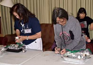 """Manzanar Committee members Kerry Cababa (left) and NCRR member Kathy Masaoka (right) are shown here during the traditional spam musubi making """"party"""" at our headquarters motel, the Dow Villa Motel in Lone Pine on the Friday before he Manzanar Pilgrimage and Manzanar At Dusk events."""