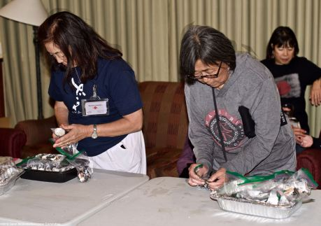 "Manzanar Committee members Kerry Cababa (left) and NCRR member Kathy Masaoka (right) are shown here during the traditional spam musubi making ""party"" at our headquarters motel, the Dow Villa Motel in Lone Pine on the Friday before he Manzanar Pilgrimage and Manzanar At Dusk events."