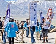 The opening processional of the banners representing the ten American concentration camps in which Japanese and Japanese Americans were unjustly incarcerated during World War II.