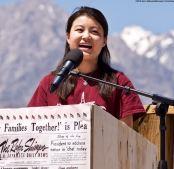 UCSD Nikkei Student Union member and 2018 Manzanar At Dusk organizer Lauren Matsumoto addresses the crowd.