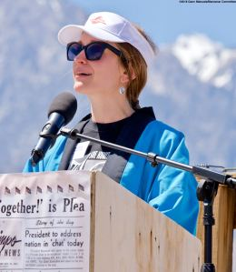 Monica Embrey, daughter of Manzanar Committee Co-Chair Bruce Embrey and grandaughter of the late Sue Kunitomi Embrey, shown here during the Roll Call of the Camps.