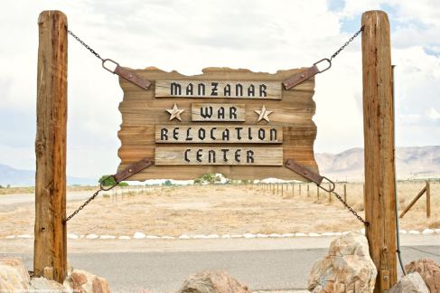 Replica of the historic sign for Manzanar at the historic entrance.