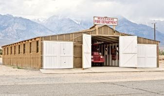 Historic replica of the Manzanar Fire Station. The truck shown is one of the fire trucks that was in service at Manzanar.