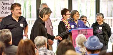 NCRR's Book Committee. From left: Lane Hirabayashi, Qris Yamashita, Richard Katsuda (obscured), Kay Ochi, Kathy Masaoka, Suzy Katsuda (partially obscured), Janice Yen.