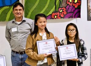 Manzanar Committee Co-Chair Bruce Embrey with award winners Victoria Yang (center) and Hazel Quach (right)
