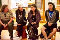 Nikkei Student Union at UCLA member Megan Yabumoto (center right) introduces herself to the group.