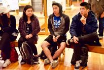 UCSD Nikkei Student Union member Kevin Amemiya (center right) introduces himself to the group.