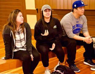 CSULB Nikkei Student Union member Kylie Castaneda (center) introduces herself to the group.