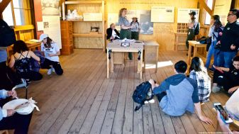 Students listening to a presentation by Ranger Patricia Biggs in the Block Manager's office in the Block 14 barracks.
