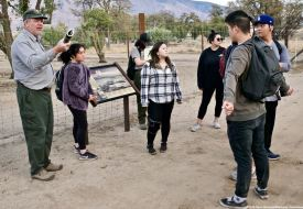 Jeff Burton (left) told our students about how the orchards from the Town of Manzanar era are being restored.