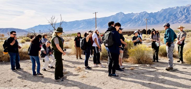 At the site of Block 20, where former Manzanar Committee Chair Sue Kunitomi Embrey was incarcerated. Her son, Manzanar Committee Co-Chair Bruce Embrey, spoke of his mother's experiences at Manzanar.
