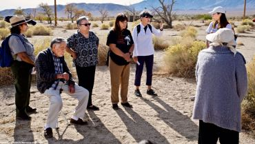 At the site of Block 20, where former Manzanar Committee Chair Sue Kunitomi Embrey was incarcerated. Her son, Manzanar Committee Co-Chair Bruce Embrey (not pictured), spoke of his mother's experiences at Manzanar.