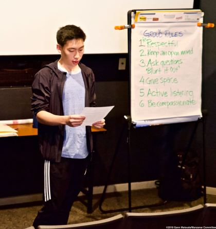 UCSD Nikkei Student Union member Kevin Amemiya reads from an oral history excerpt during discussion on what happened to the incarcerees once Manzanar closed after the end of World War II.