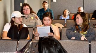 Nikkei Student Union at UCLA member Megan Yabumoto (center) reads from an oral history excerpt during discussion on what happened to the incarcerees once Manzanar closed after the end of World War II.