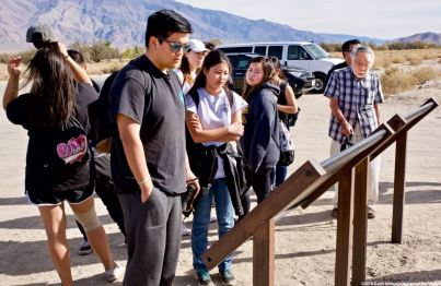 At the Manzanar cemetery. Students reading the two wayside exhibits there.