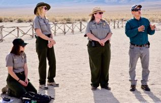 Manzanar Committee Co-Chair Bruce Embrey (right) during a discussion about community activism at the cemetery monument.