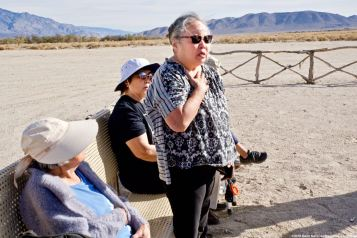 Manzanar Committee Co-Chair Jenny Chomori during a discussion about community activism at the cemetery monument.