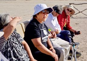 Nancy Oda (center) during a discussion about community activism at the cemetery monument.