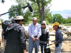 Henry, with Arthur Ogami (left) and his wife, Kimi, discussing their experiences at Manzanar.