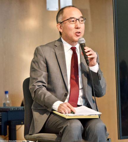 Panel moderator Brian Niiya