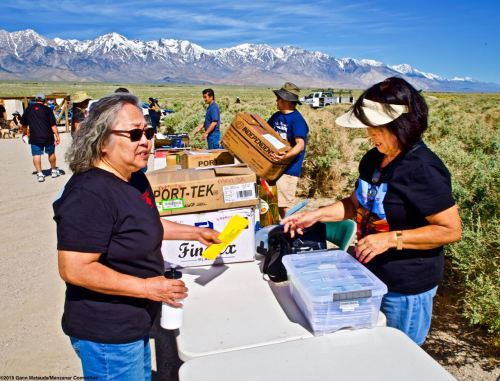 Manzanar Committee Co-Chair Jenny Chomori (left) and volunteer Janet Fujii (right), shown here during preparation work prior to the start of the 50th Annual Manzanar Pilgrimage, April 27, 2019,, at the Manzanar National Historic Site.