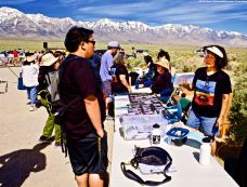 Manzanar Committee Co-Chair Jason Fujii (left) and volunteer Janet Fujii (right; Jason's mother), shown here during preparation work prior to the start of the 50th Annual Manzanar Pilgrimage, April 27, 2019, at the Manzanar National Historic Site.