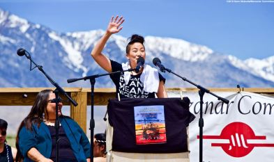 Co-emcee traci-kato kiriyama, shown here, opening the 50th Annual Manzanar Pilgrimage, April 27, 2019, at the Manzanar National Historic Site.