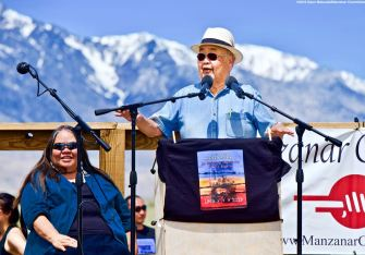 Co-emcee Warren Furutani (center), shown here with Kathy Jefferson Bancroft of the Lone Pine Paiute Shoshone Reservation (left), opening the 50th Annual Manzanar Pilgrimage, April 27, 2019, at the Manzanar National Historic Site.