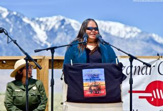 Kathy Jefferson Bancroft of the Lone Pine Paiute Shoshone Reservation (left), opening the 50th Annual Manzanar Pilgrimage, April 27, 2019, at the Manzanar National Historic Site.