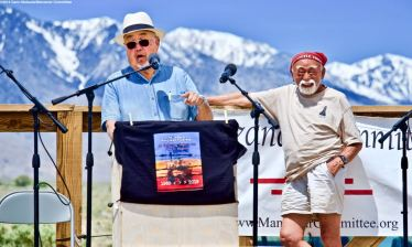 Co-emcee Warren Furutani, shown here introducing Mo NIshida, who attended the first organized Manzanar Pilgrimage in 1969, addresses the crowd during the 50th Annual Manzanar Pilgrimage, April 27, 2019, at the Manzanar National Historic Site.