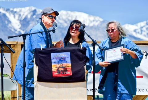 Manzanar Committee Co-Chairs Bruce Embrey (left) and Jenny Chomori (right), shown here honoring Manzanar Committee member Joyce Okazaki (center) for her educational work on behalf of the Manzanar Committee, during the 50th Annual Manzanar Pilgrimage, April 27, 2019, at the Manzanar National Historic Site.