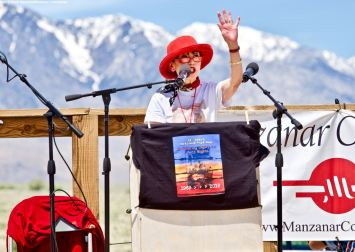 Karen Korematsu founder and Executive Director of the Fred T. Korematsu Institute, addresses the crowd during the 50th Annual Manzanar Pilgrimage, April 27, 2019, at the Manzanar National Historic Site.