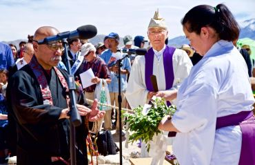 Rev. William Briones(left) participates in the Shinto purification rite during the interfaith service. 50th Annual Manzanar Pilgrimage, April 27, 2019, at the Manzanar National Historic Site.