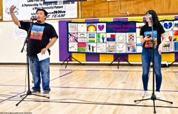 Manzanar Committee members Jason Fujii (left) and Wendi Yamashita (right) during the opening of the 2019 Manzanar At Dusk program, Aoril 27, 2019, at Lone Pine High School.