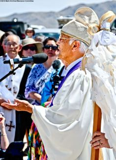 The interfaith service during the 50th Annual Manzanar Pilgrimage. Rev. Alfred Tsuyuki of the Konko Church of Los Angeles performed the Shinto rite of purification.