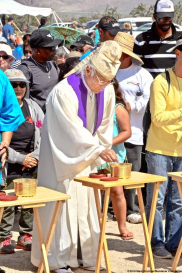 Rev. Alfred Tsuyuki of the Konko Church of Los Angeles offers incense during the Buddhist portion of the interfaith service.