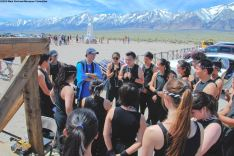 Manzanar Committee member Gann Matsuda (in blue), shown here speaking with UCLA Kyodo Taiko.
