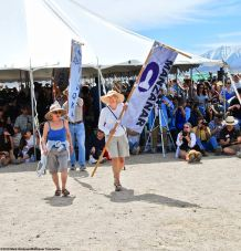 Pat Sakamoto carrying the Manzanar banner during the 50th Annual Manzanar Pilgrimage.