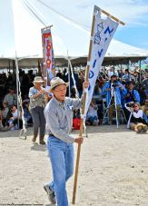 LInden Nishinaga carrying the Minidoka banner during the 50th Annual Manzanar Pilgrimage.