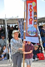 Hatsuko Mary Higuchi carrying the Poston banner during the 50th Annual Manzanar Pilgrimage.