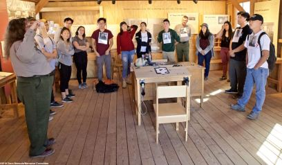 "Back in the Block 14 demonstration barracks (Block Manager's office) for a presentation on the Manzanar ""Riot."""
