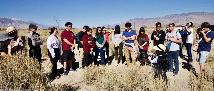 The location of Block 31 at Manzanar. Former Manzanar incarceree Yoshiye Okimoto Haoashi (foreground, seated) is shown here telling students about her life in Block 31