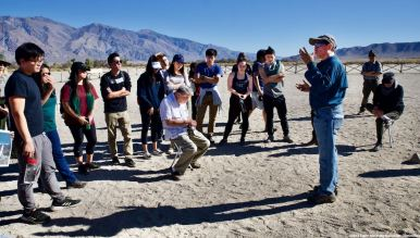 Day 2 at the Manzanar cemetery where students learned about the first organized Manzanar Pilgrimage in 1969, about the activism that has kept it going for 50 years and about how critical that same kind of activism is today. That's Manzanar Committee Co-Chair Bruce Embrey speaking (right).