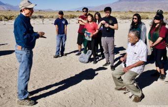 Day 2 at the Manzanar cemetery where students learned about the first organized Manzanar Pilgrimage in 1969, about the activism that has kept it going for 50 years and about how critical that same kind of activism is today. That's Manzanar Committee Co-Chair Bruce Embrey speaking (left).