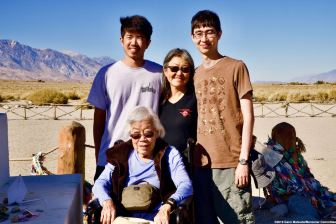 Former Manzanar incarceree Yoshiye Okimoto Hayashi (seated) with her grandson, Cameron Solomon (top right), her daughter, Linda Solomon (top center) and her great-nephew, Darren Kawasaki of the Manzanar Committee.