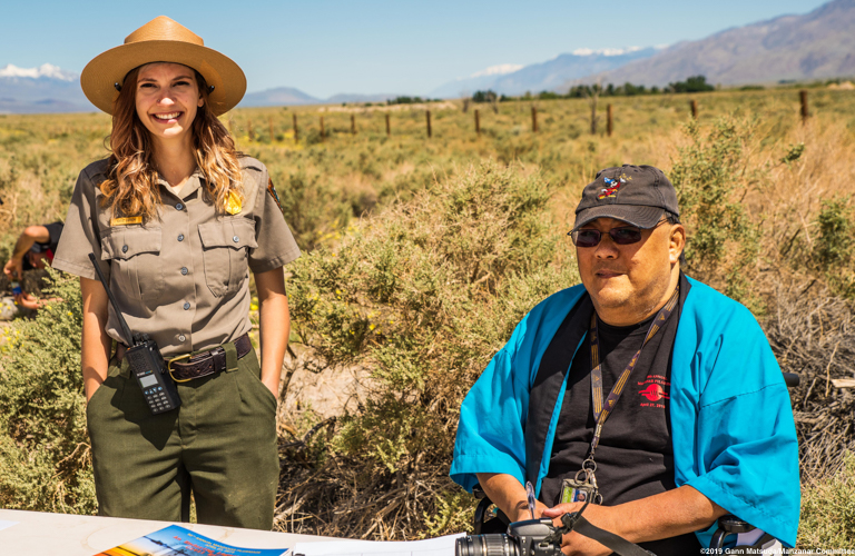 Manzanar Committee member James (Jim) To (right), shown here with former Manzanat National Historic Site staff member Katie Busch, during the 50th Annual Manzanar Pilgrimage, April 27, 2019, at the Manzanar National Historic Site. Photo by Gann Matsuda/Manzanar Committee.